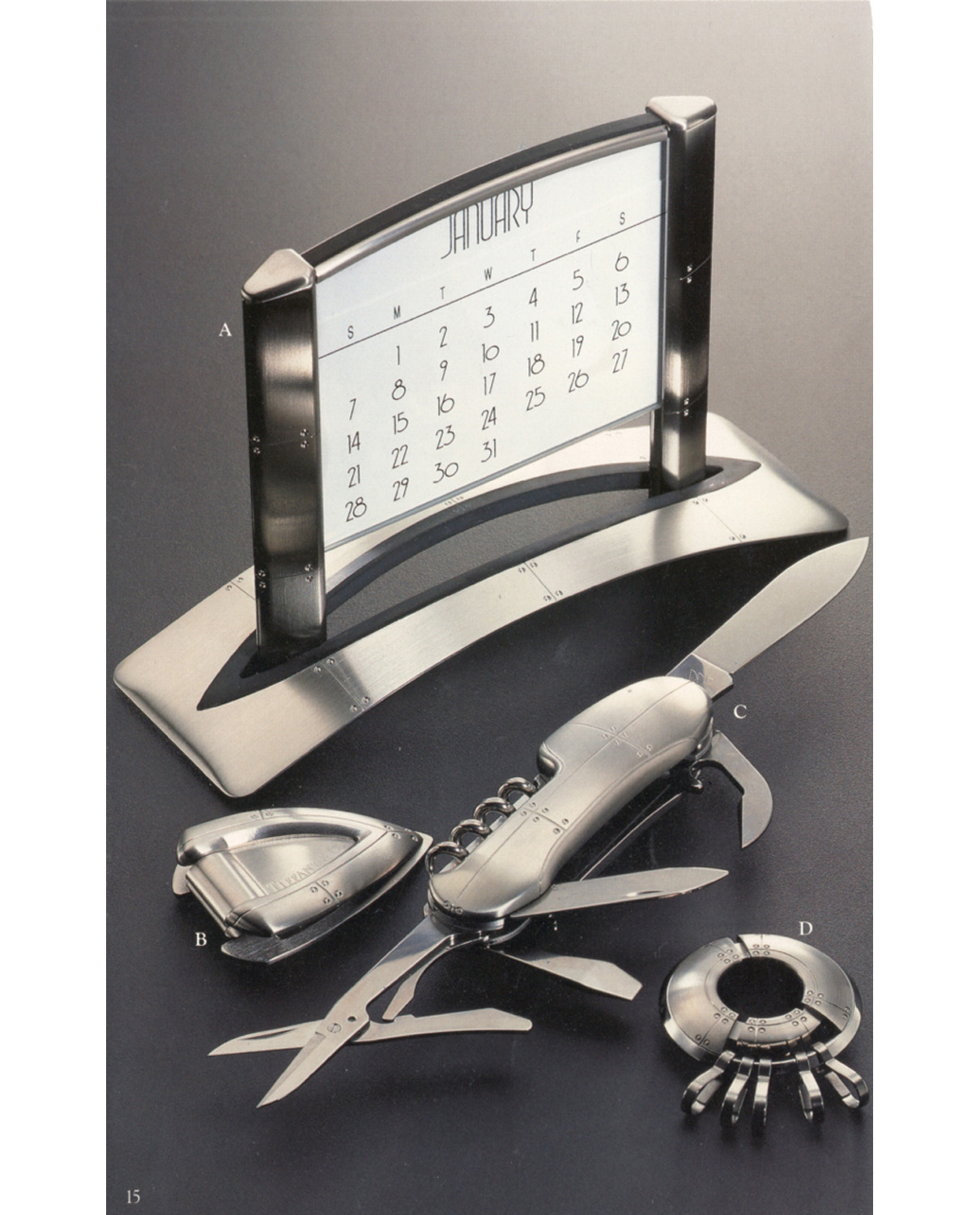 •	Tiffany & Co. Blue Book Catalog late 90's Streamerica Stainless Steel Collection: Airframe Perpetual Calendar, Laminar Money Clip, Carapace Pocket Knife, and Porthole Keyring.