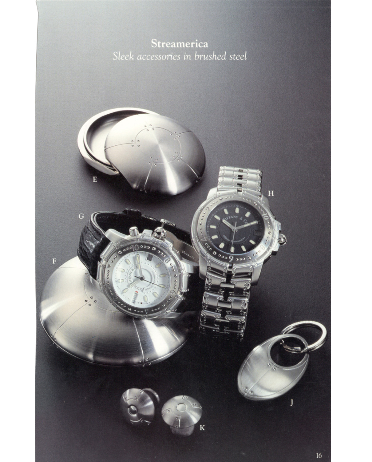 Tiffany & Co. Blue Book Catalog from the late 90's Sleek accessories in brushed steel Streamerica Collection: Perisphere Nesting Boxes, the World Timer Automatic Watch with white face and leather band, the Automatic Chronometer, geodome cufflinks, Curviline key ring.