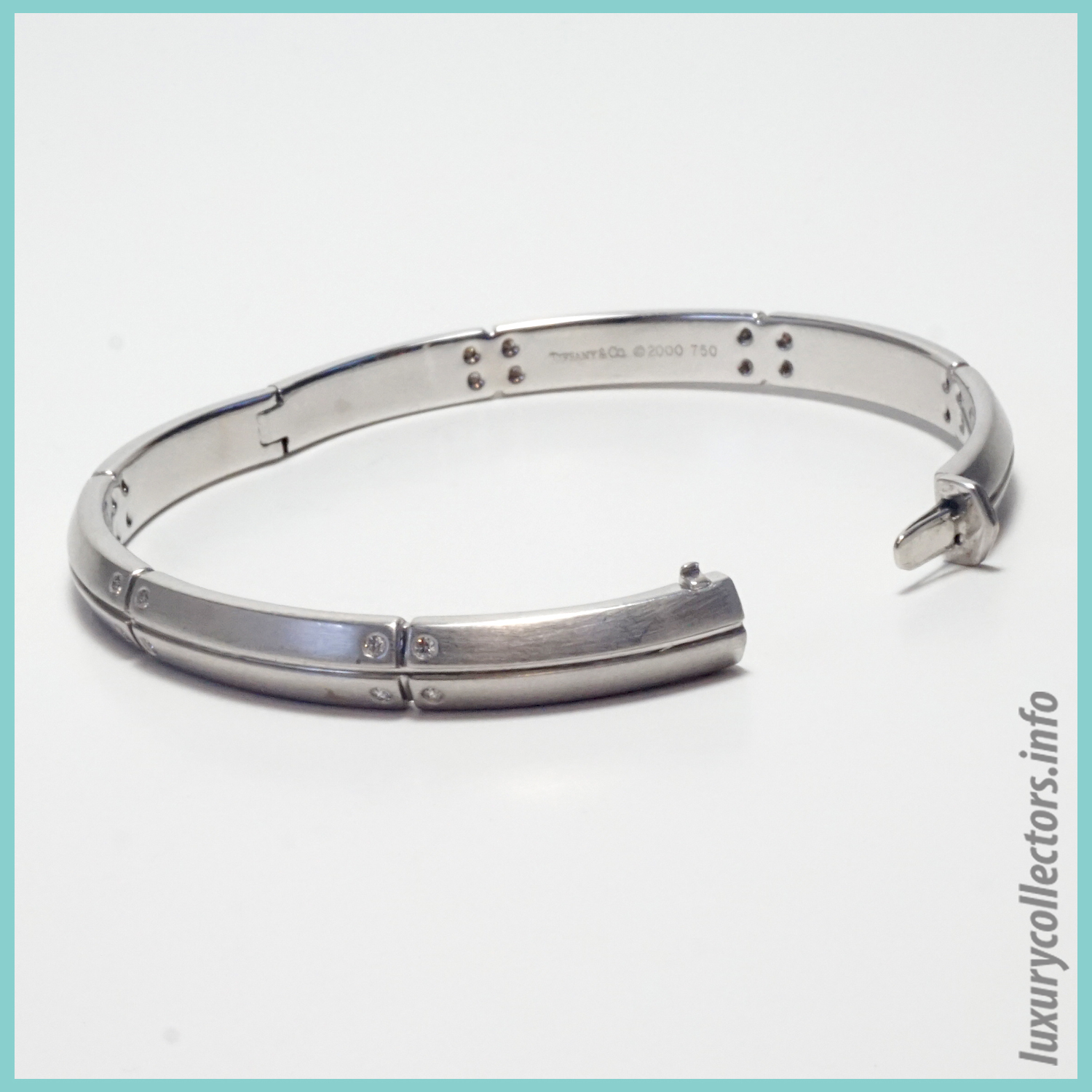 Tiffany & Co. Streamerica 18K White Gold Collection Diamonds 2000 2002 Bangle Bracelet Stamped open mechanism latch