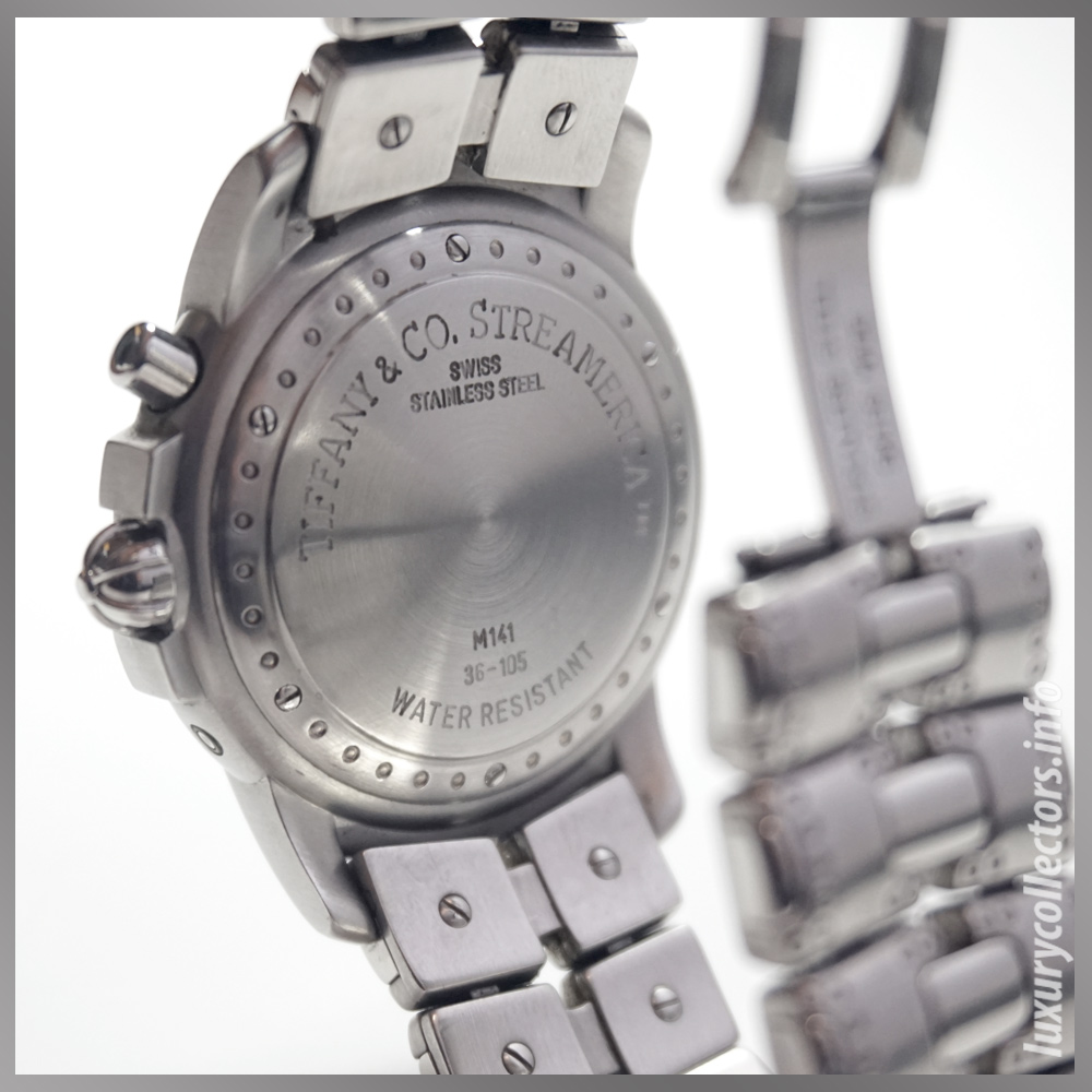 Backview World Time Watch. Marked Case: Tiffany & Co. Streamerica™, Swiss, Stainless Steel, M141, 36-105, Water Resistant.