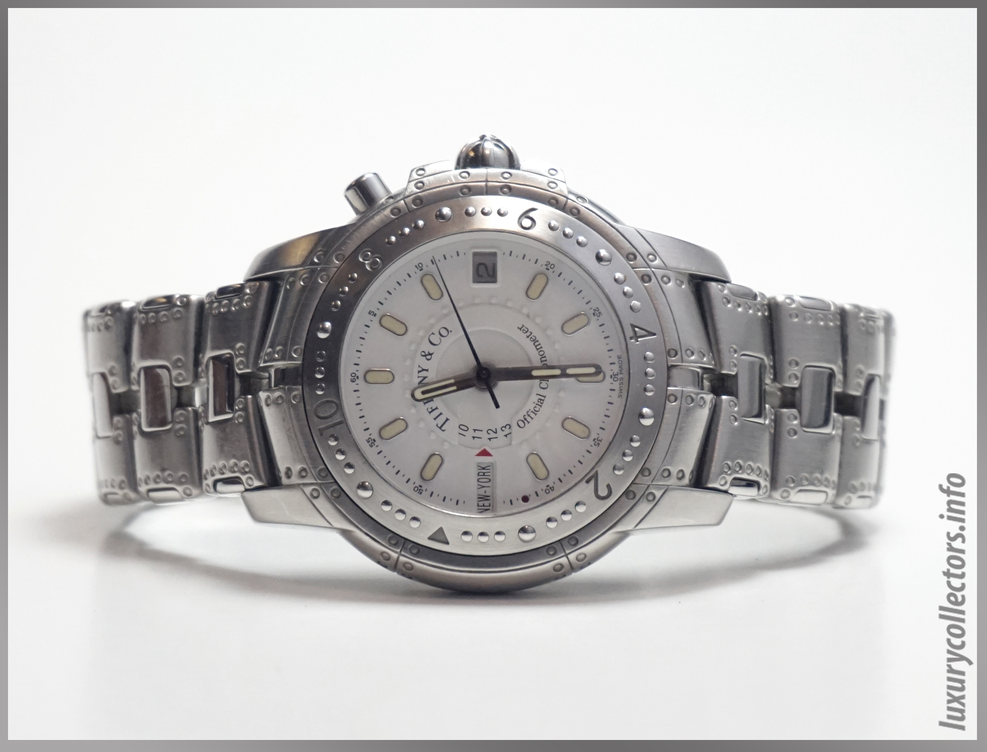 Tiffany & Co. Streamerica World Time Automatic Chronometer Wristwatch in all stainless steel and white face.